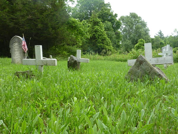 Gravestones mark burial sites in Grindstone Island's official cemetery.