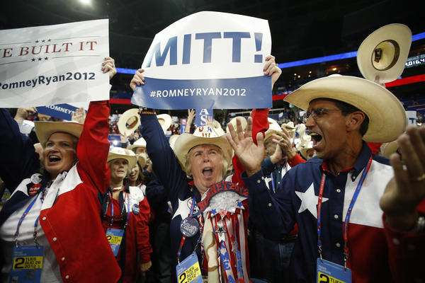 Texas delegates cheer as Romney is formally nominated as the Republican Party's presidential candidate.