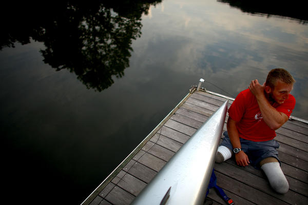 Jones sits on the dock at the Rivanna Reservoir before putting his boat in the water. The Paralympic movement began half a century ago when disabled vets from World War II started looking for a way to continue active lifestyles.