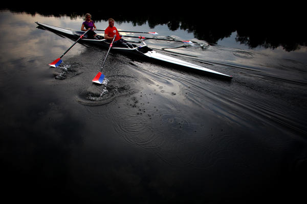 The teammates use a specially adapted rowing shell that is rigged with attachments so they can row comfortably, and slip in and out of the boat on their own.
