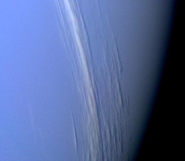 About three years later, in 1989, Voyager 2 reached Neptune, where it captured this high-resolution color image, which shows bright cloud streaks on the planet.