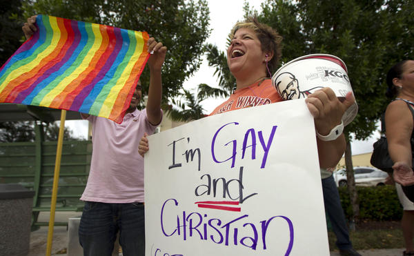 Carri Jo Anderson joins the protest in front of a Chick-fil-A restaurant in Pompano Beach, Fla., in August. As views on homosexuality change, more states are challenging the federal definition of marriage