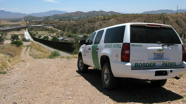 A Border Patrol vehicle patrols the fence separating the cities of Nogales, Ariz., and Nogales, Sonora. The fence has been rebuilt twice.