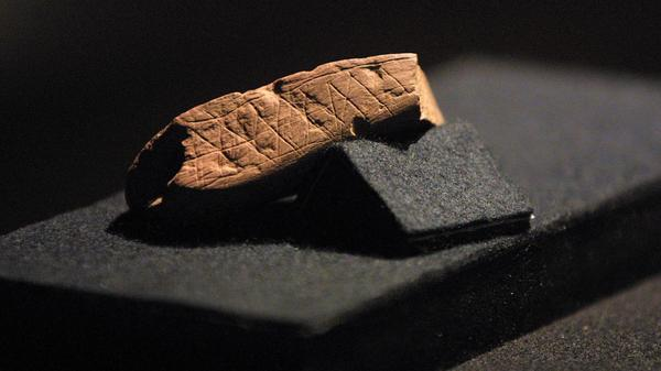 A piece of red ochre with a deliberately engraved design is pictured here at Cape Town's Iziko/South African Museum in 2002. The piece was discovered in Blombos Cave near Stilbaai, about 300 kilometers from Cape Town.
