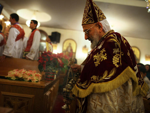 Father Mina celebrates the Christmas Nativity Liturgy, the start of Christmas, at the Coptic Orthodox Church of St. George on Jan. 6 in Brooklyn, N.Y. Coptic churches around the country have witnessed a surge of Christians fleeing Egypt since the start of the Arab Spring.