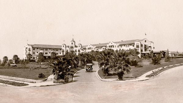 The Beverly Hills Hotel as it looked when it opened in 1912. The bleak landscape would eventually be replaced by lush tropical foliage, and after the depression, the white Spanish Mission-style hotel would be painted its now-famous pink.