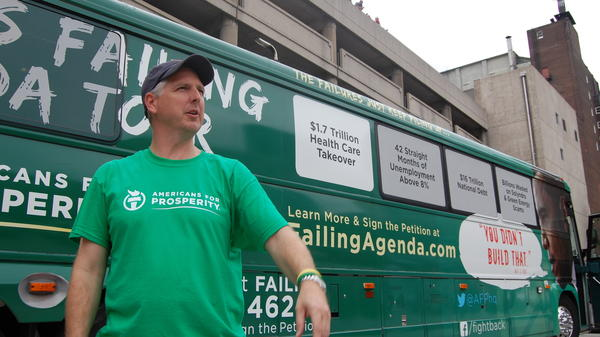 Patrick Werner, Missouri state director for Americans for Prosperity, outside the St. Louis Rams-Washington Redskins football game Sunday in St. Louis.