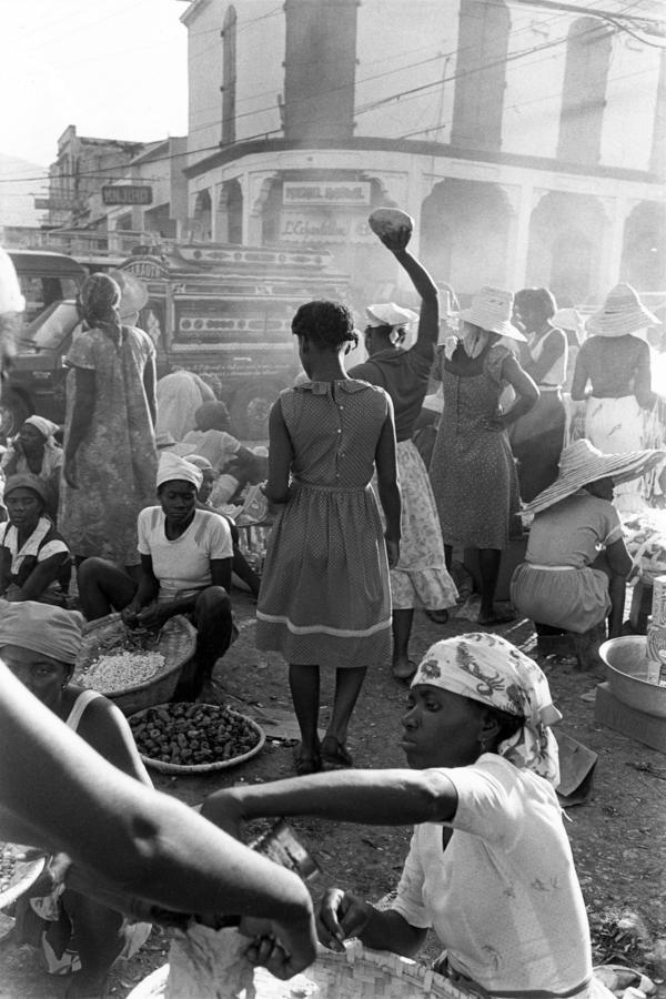 Woman lifting fruit on downtown street, Port-au-Prince, Haiti, 1985