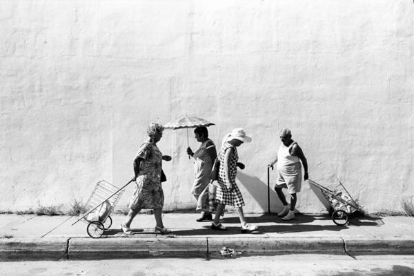 Four people on sidewalk at Sixth Street, South Beach, Miami Beach, 1978