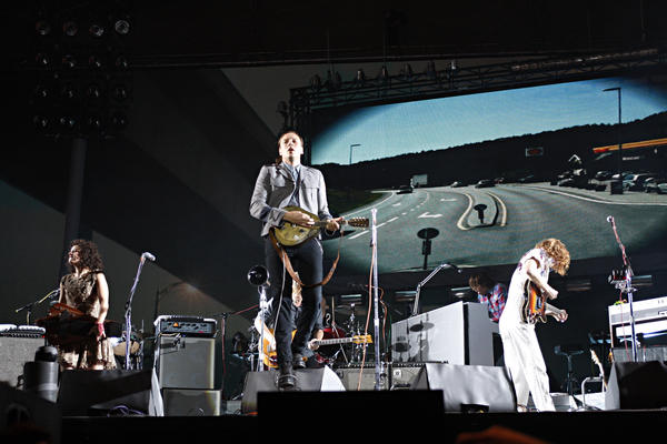 Though the Canadian band Arcade Fire is led by singer Win Butler on most songs, the group has cultivated a communal image.
