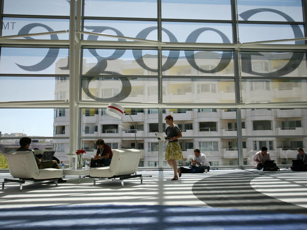 """A Google logo is seen through windows of Moscone Center in San Francisco during Google's annual developer conference, Google I/O, in June. Google is one of several major tech companies known for the """"acqui-hire."""""""
