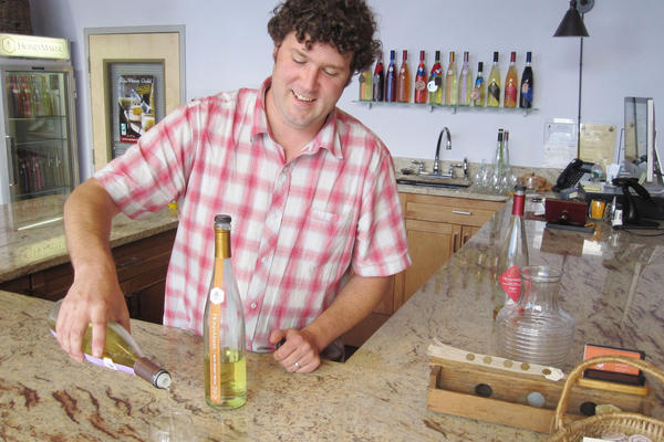 Maine Mead Works owner Ben Alexander pours a sample of his dry mead.