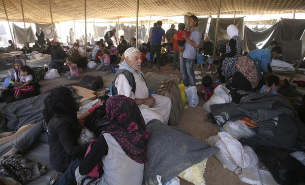 Newly arrived Syrian refugees gather at Zaatari camp, in Mafraq, Jordan, Aug. 29. Residents have rioted over the poor living conditions at the camp. The Jordanian government is not allowing Syrians to leave the camp and join friends or family elsewhere in the country.