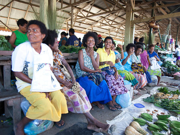 While some villages that cater to tourists have areas that discourage Western dress, many Papua New Guineans, like these women at a market not frequented by tourists, do wear modern clothes.