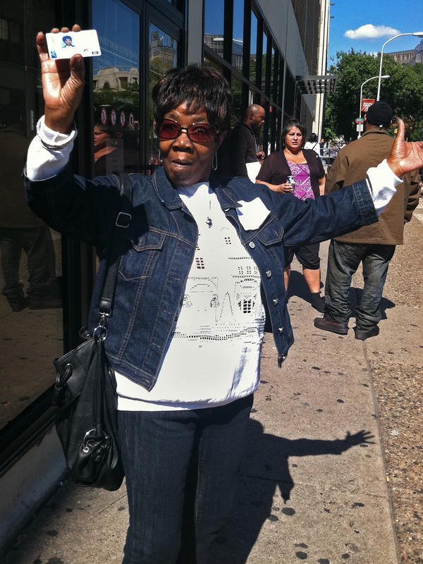 Beverly Mitchell shows off her new photo ID card outside a Philadelphia DMV office. She decided to get the card in case a Pennsylvania court rules to allow the enactment of a state law that requires voters to show photo ID in order to vote.
