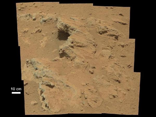 <strong>Curiosity 2012:</strong> A wider view of the outcrop of a former streambed shows bedrock that scientists believe was likely exposed by meteorites striking the surface of Mars.