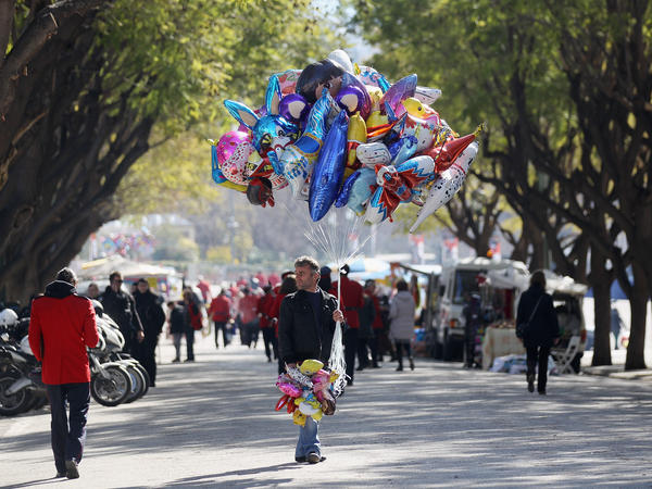A man selling helium balloons at a local festival on Feb. 19, in Athens, Greece.
