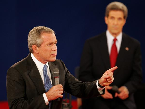 "In a 2004 debate in St. Louis, President Bush answers a question as his opponent, Sen. John Kerry, listens. Both candidates used a number of ""pivots"" in their debates."