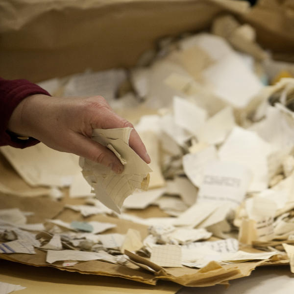 A worker in the former headquarters of the Stasi sorts hundreds of thousands of torn or shredded Stasi documents in January. Workers are sifting through thousands of bags, containing between 50,000 and 80,000 fragments each.