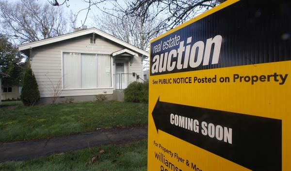 An auction sign in front of a Salem, Ore., home on Feb. 23.