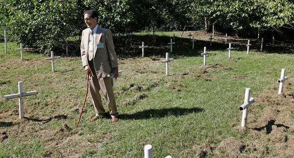 Dick Colon, one of the White House Boys, walks through grave sites near the Dozier School for Boys in Marianna, Fla. Several men who suffered abuse and severe beatings believe the crosses mark the graves of boys who were killed at the school, victims of punishments that went too far.
