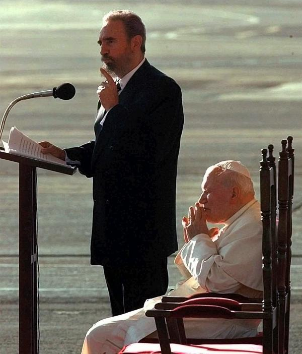 Pope John Paul II listens as Castro makes remarks on Jan. 21, 1998, during a welcoming ceremony at Jose Marti Airport in Havana. The pope arrived for a historic five-day visit.