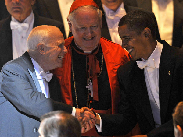 Republican presidential candidate Sen. John McCain (left) and Democratic presidential candidate Barack Obama at the Alfred E. Smith Memorial Foundation Dinner on Oct. 16, 2008. At center is Bishop Edward Michael Cardinal Egan.