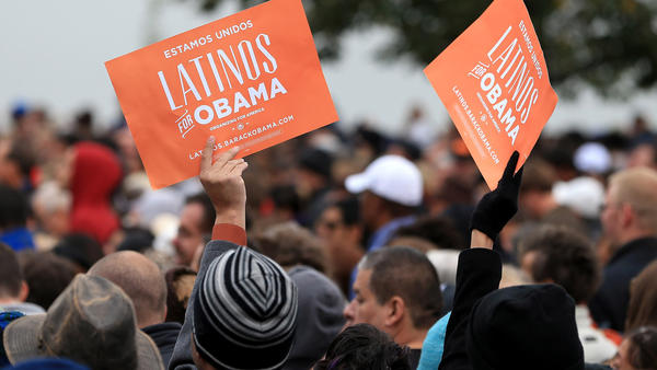 Latino supporters hold up signs as they attend a campaign rally for President Obama at Sloan's Lake Park in Denver on Oct. 4.