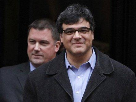 Former CIA officer John Kiriakou (right), accompanied by his attorney, John Hundley, leaving federal court in Alexandria, Va., last January.