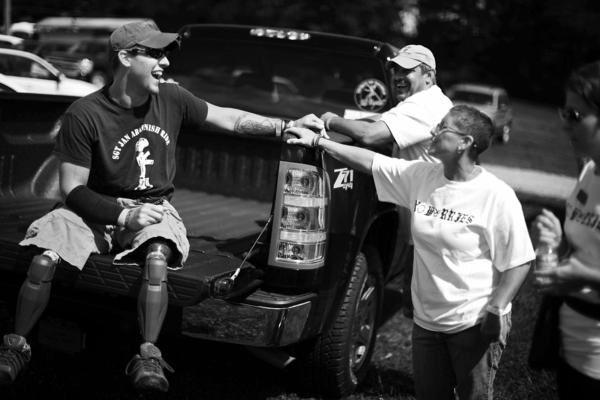 Nick Staback, who lost both of his legs to a bomb in Afghanistan, talks with his mother, Maria Staback, in Scranton, Pa. Maria Staback took a leave of absence from her job to move in with her son while he was recuperating at Walter Reed National Military Medical Center outside Washington, D.C.