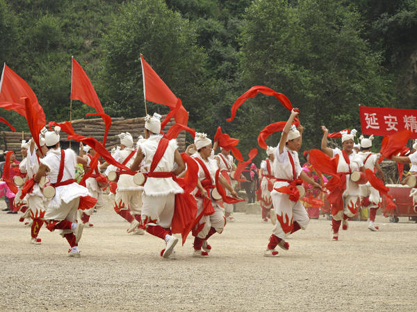 """Traditional Shaanxi folk dances also lighten the mood during """"The Defense of Yan'an,"""" which ends with a rendition of """"Socialism is Good"""" that the audience joins."""