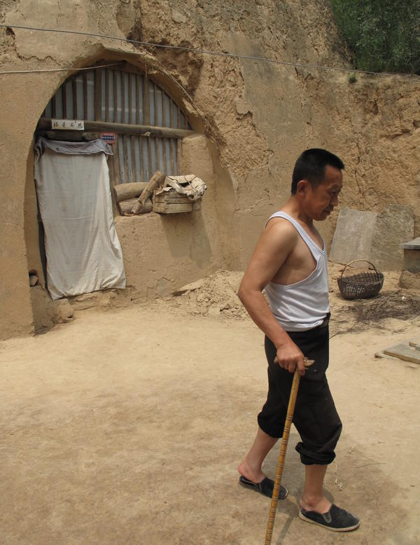 "Guo limps across the yard of his cave home, which has no running water. He says he is a big supporter of the Communist Party, but admits he envies city folk, who ""live and eat and do everything better than us"" country folk."