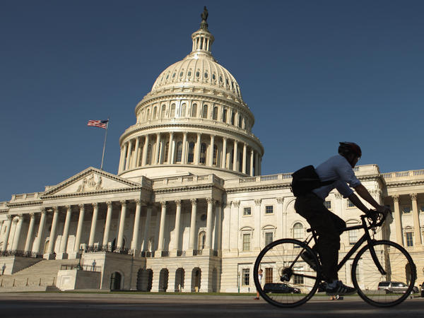 A bicyclist rides through the plaza on the east side of the U.S. Capitol in Washington, D.C.