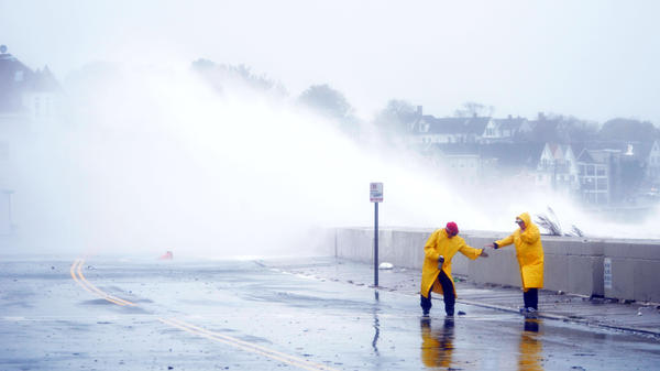 Waves crashed over a road in Winthrop, Mass., as Hurricane Sandy moved toward coastal areas Monday.