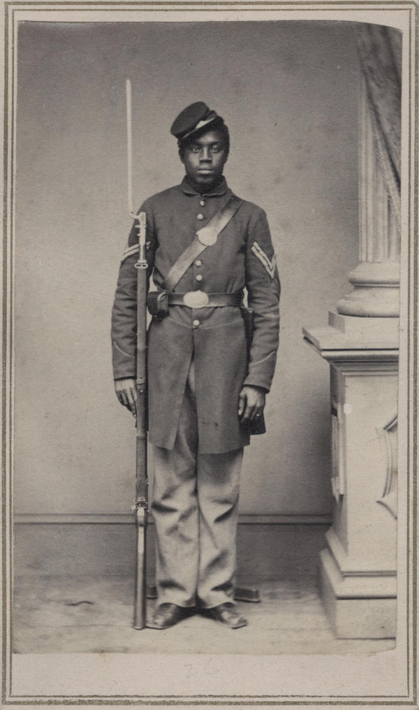 "Corp. Wilson Weir was a slave when he joined the Union army at age 21. ""My initial attraction to old photos was purely aesthetic, and this still continues to be the dominant motivating factor,"" writes Coddington. ""This <em>carte de visite</em> meets and exceeds my criteria. ... He wears his hat at a jaunty angle, perhaps reflective of his character."""