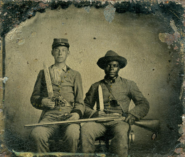"This rare portrait shows an identified Confederate noncommissioned officer, Sgt. Andrew Martin Chandler (left), and his named slave, Silas Chandler (right). It is the only Confederate photograph in the book by Rod Coddington, <em>African American Faces of the Civil War</em>. Born into slavery, Silas ""was one of thousands of slaves who served as [body servants] during the war,"" writes Coddington."