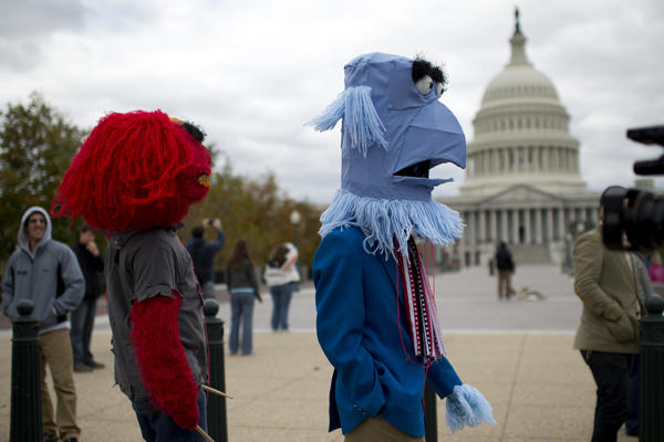 PBS supporters take part in the Million Puppet March, which featured entertainment from puppeteers, music and remarks from supporters around the country.