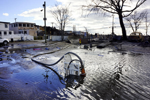 "Firefighters are part of a massive de-watering effort in Breezy Point. ""We're trying to put the water back where it came from,"" says Chief Pfeifer."