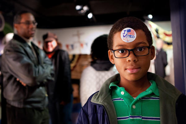 Noah Hope, 10, shows off his <em>I Voted</em> sticker during the children's mock Election Day at Madame Tussaud Wax Museum in Washington D.C.