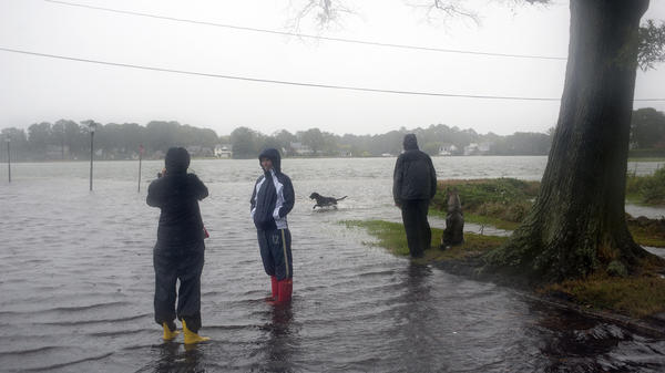 Residents of the Colonial Place neighborhood watch as heavy rain from Hurricane Sandy floods the Lafayette River in Norfolk, Va., on Oct. 28.