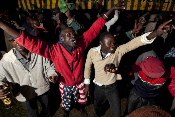 Kenyans dance at a watch party for the U.S. presidential election in Kogelo village, home to President Obama's step-grandmother. Kenyans were elated by the president's re-election.