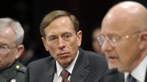 Members of Congress want to know why they didn't know more about the investigation involving former CIA Director David Petraeus, seen here testifying on Capitol Hill on Feb. 2.