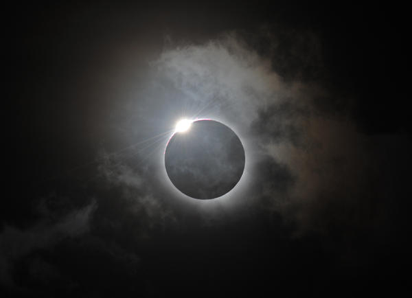 The Diamond Ring effect is shown following totality of the solar eclipse at Palm Cove in Australia's Tropical North Queensland Wednesday.