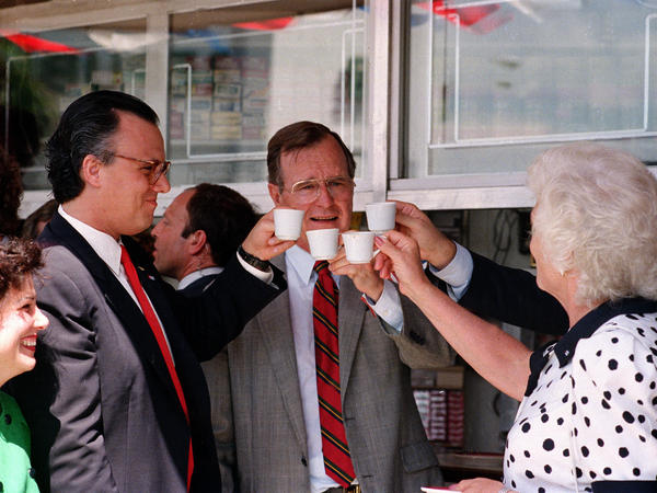 Vice President George H.W. Bush toasts with cups of Cuban coffee on June 17, 1987, in the Little Havana neighborhood of Miami. Bush, who was in Florida to raise funds for his bid for the Republican presidential nomination, stopped at the restaurant after ceremonies renaming a street in the neighborhood for President Reagan.