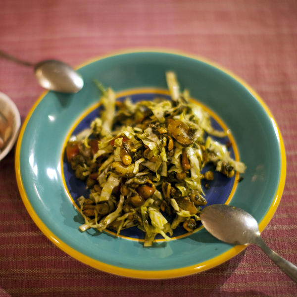 One of the restaurant's most popular dishes is the Burmese green tea leaf salad with crunchy fried nuts.