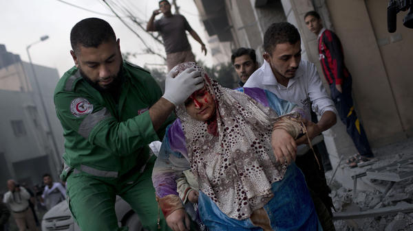 The Israelis and Palestinians have clashed repeatedly over the Gaza Strip, but the recent upheavals in the Middle East have changed the dynamics this time. Here, a Palestinian woman is helped after being injured in an Israeli strike in Gaza City on Monday.