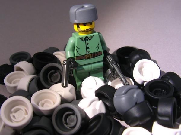 This figure is wearing the BrickArms Ushanka (Russian hat), and holding the BrickArms TT-33 pistol and PPSh submachine gun. The uniform is a Lego design from the Indiana Jones Lego series.