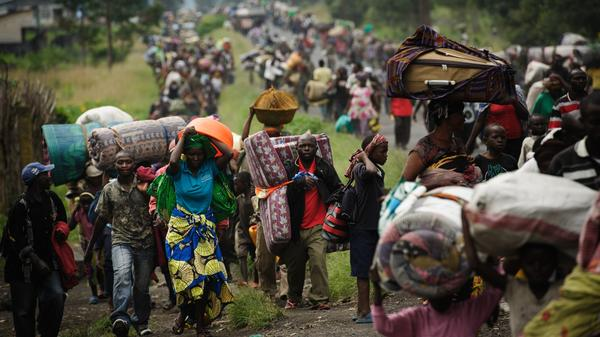 To escape fighting, thousands of civilians flee the town of Sake in the eastern part of the Democratic Republic of the Congo on Thursday. Rebels captured Sake and made other advances in the area this week. Eastern Congo and the larger region have been the scene of frequent fighting over the past two decades.