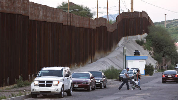 Pedestrians cross the street in Nogales, Mexico, near the border with Arizona. A U.S. Border Patrol agent shot and killed a 16-year-old boy who was throwing rocks near the border fence last month.