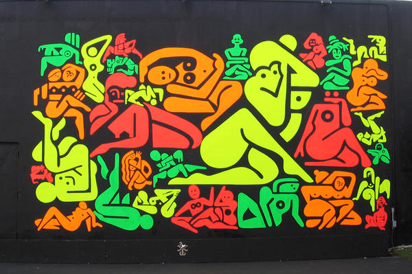 Ryan McGinness' 33 Women uses red, orange, green and yellow DayGlo paint on a black background.